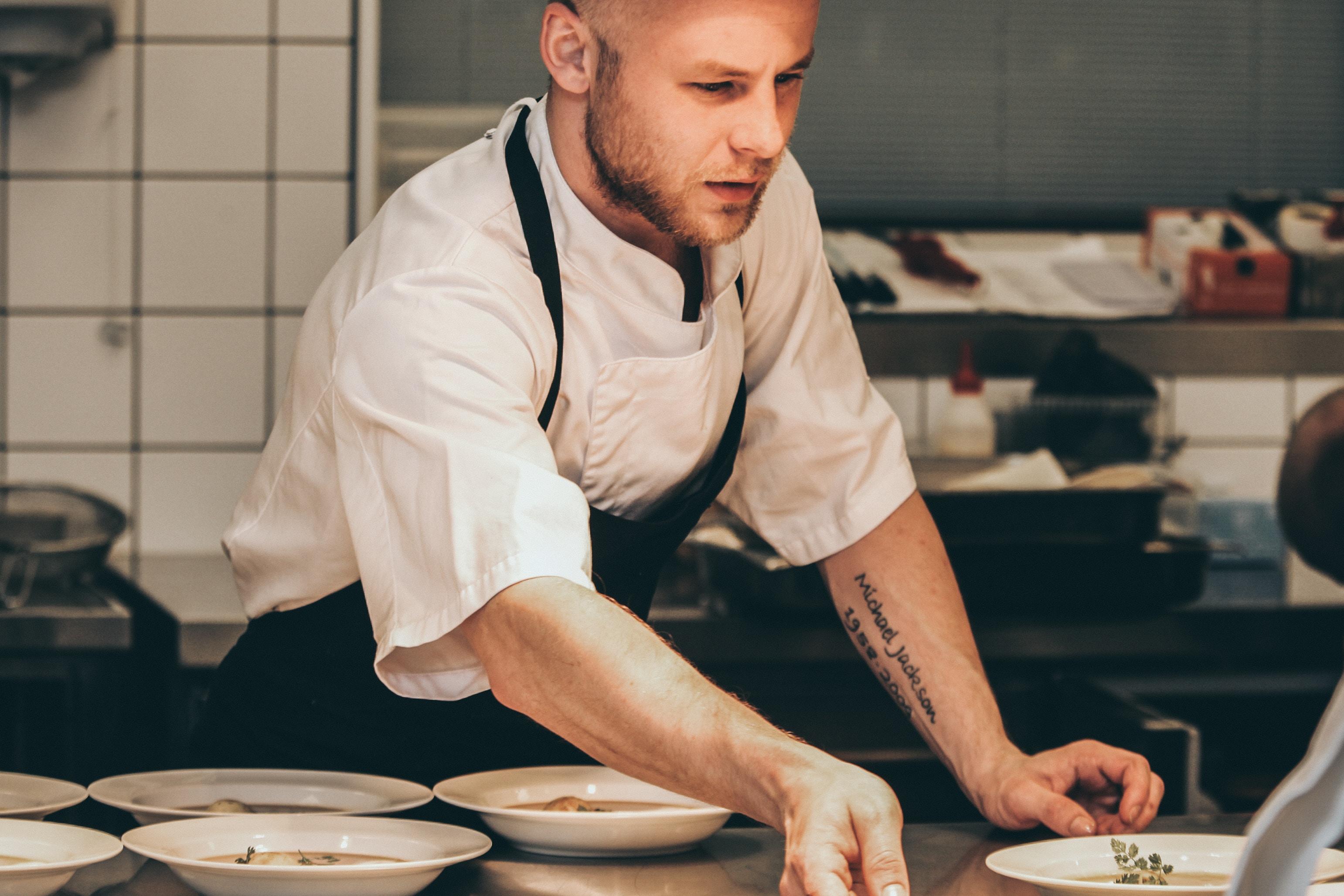 chef making dish inside the kitchen