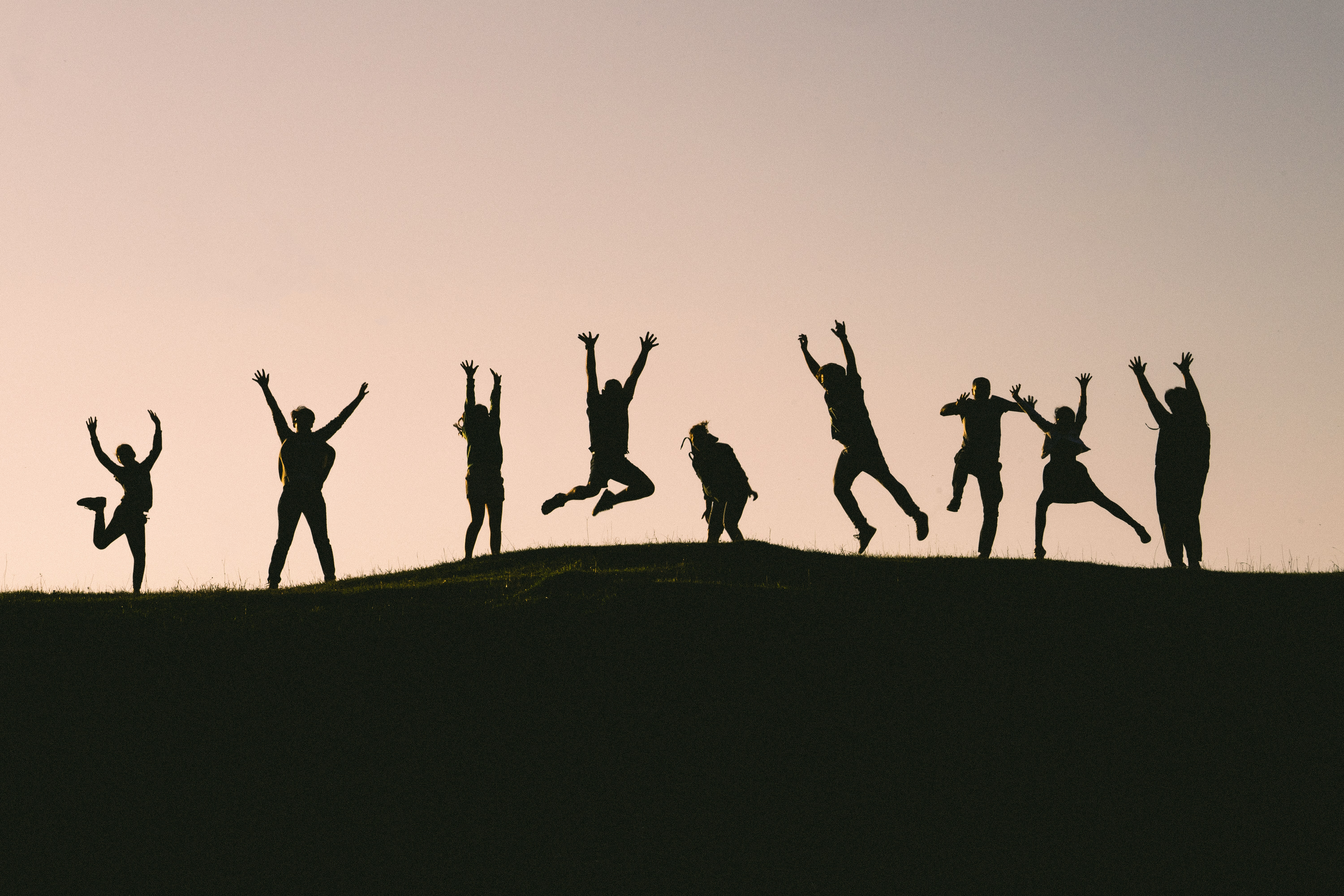 silhouette photo of group of people on mountain