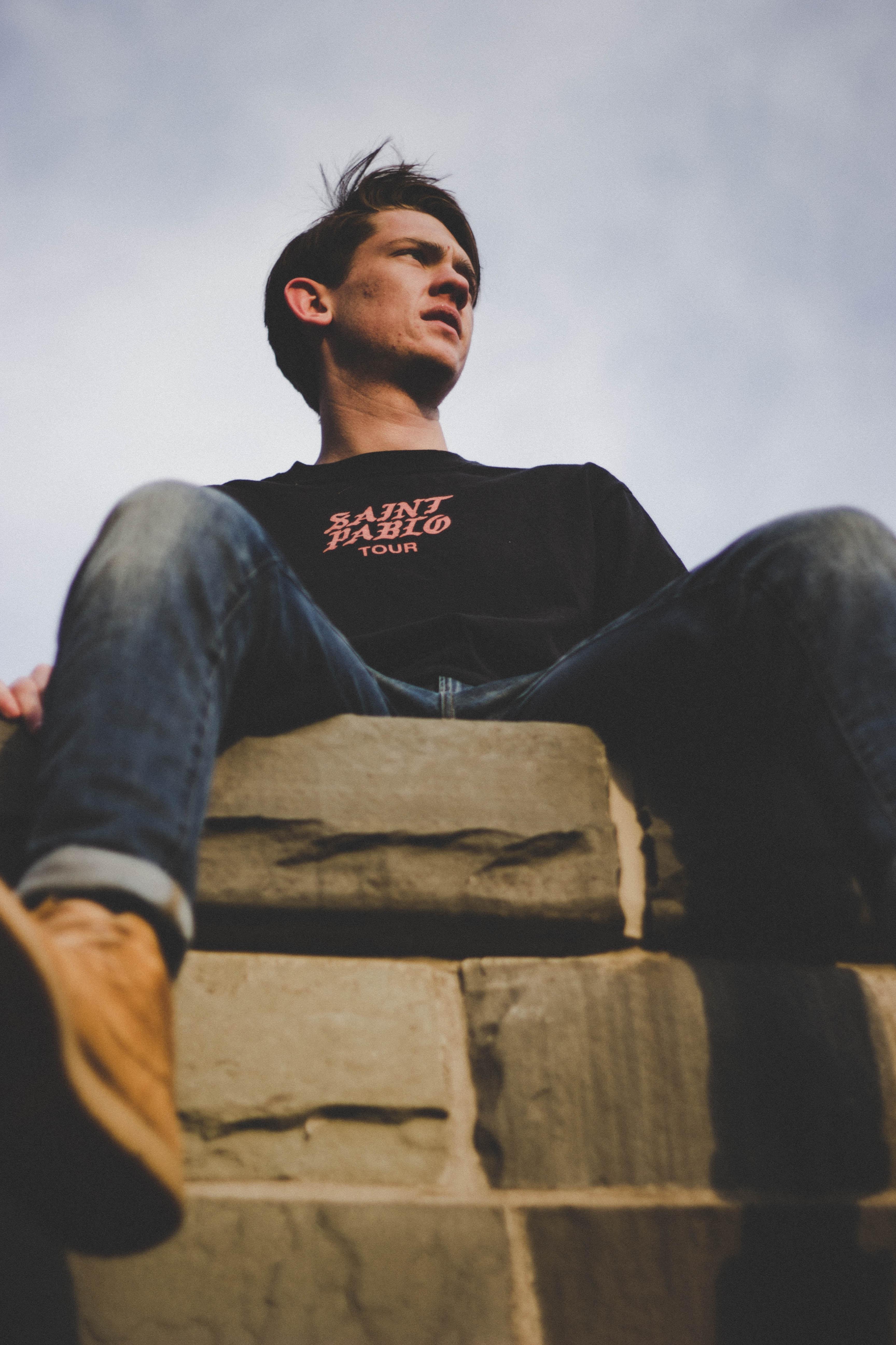 man sitting on gray surface