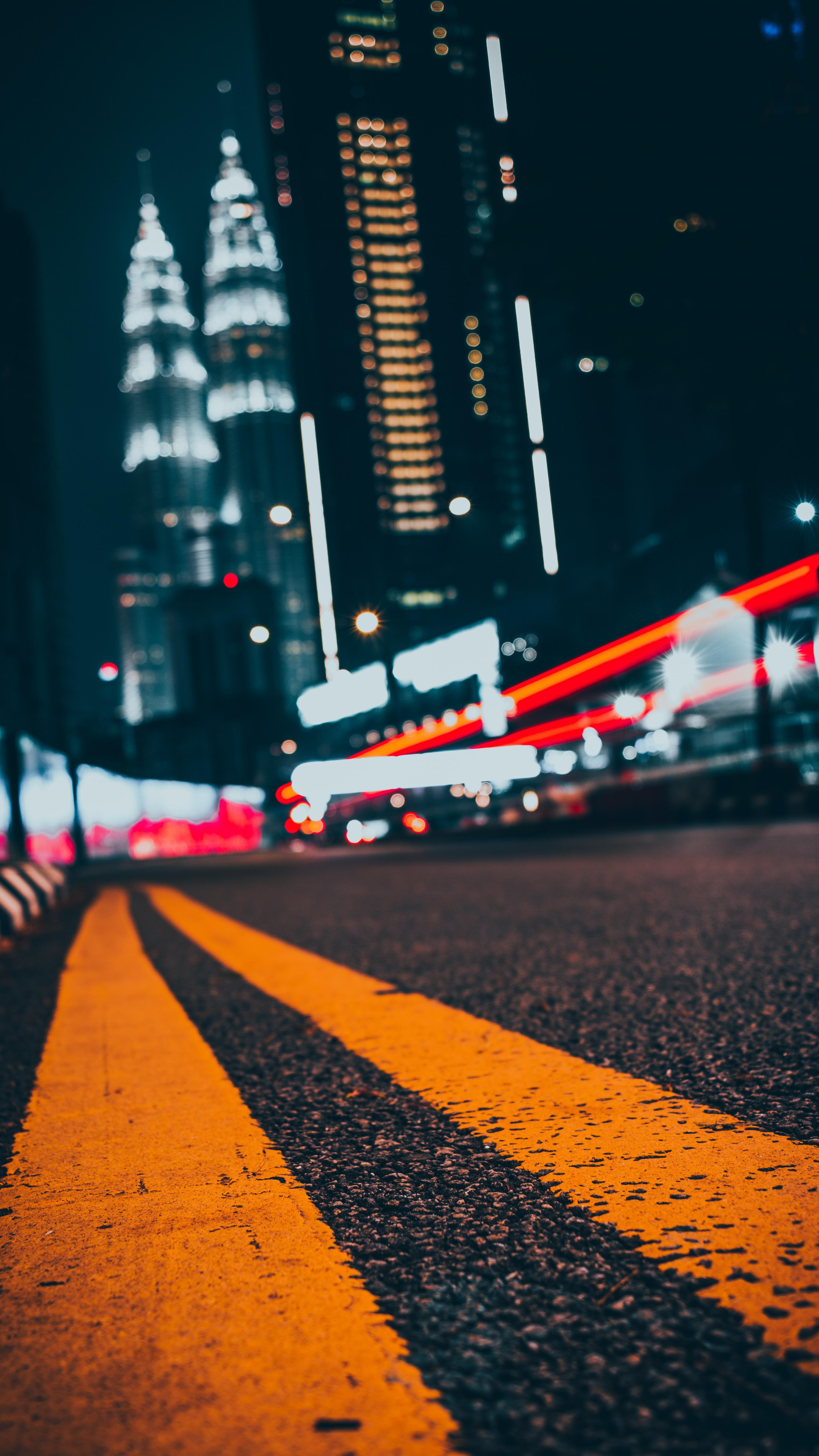 yellow pedestrian lane in road near concrete building during nighttime