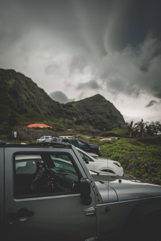 gray car near mountain