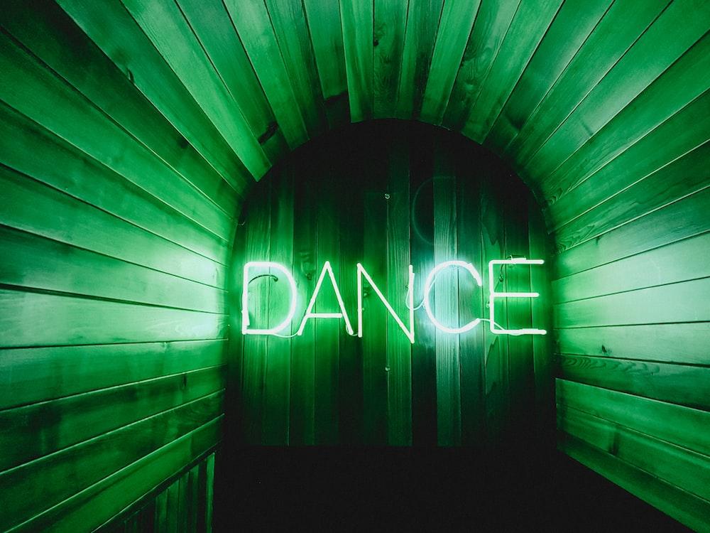 brown door with Dance neon lights
