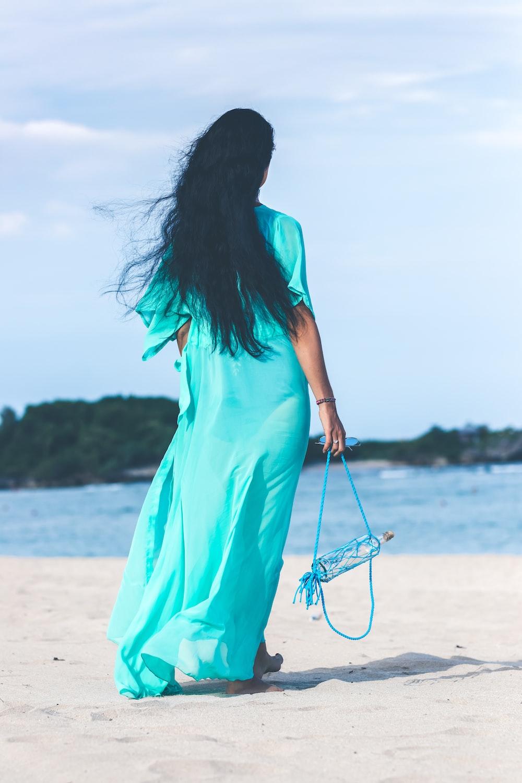 woman holding bottle near the seashore