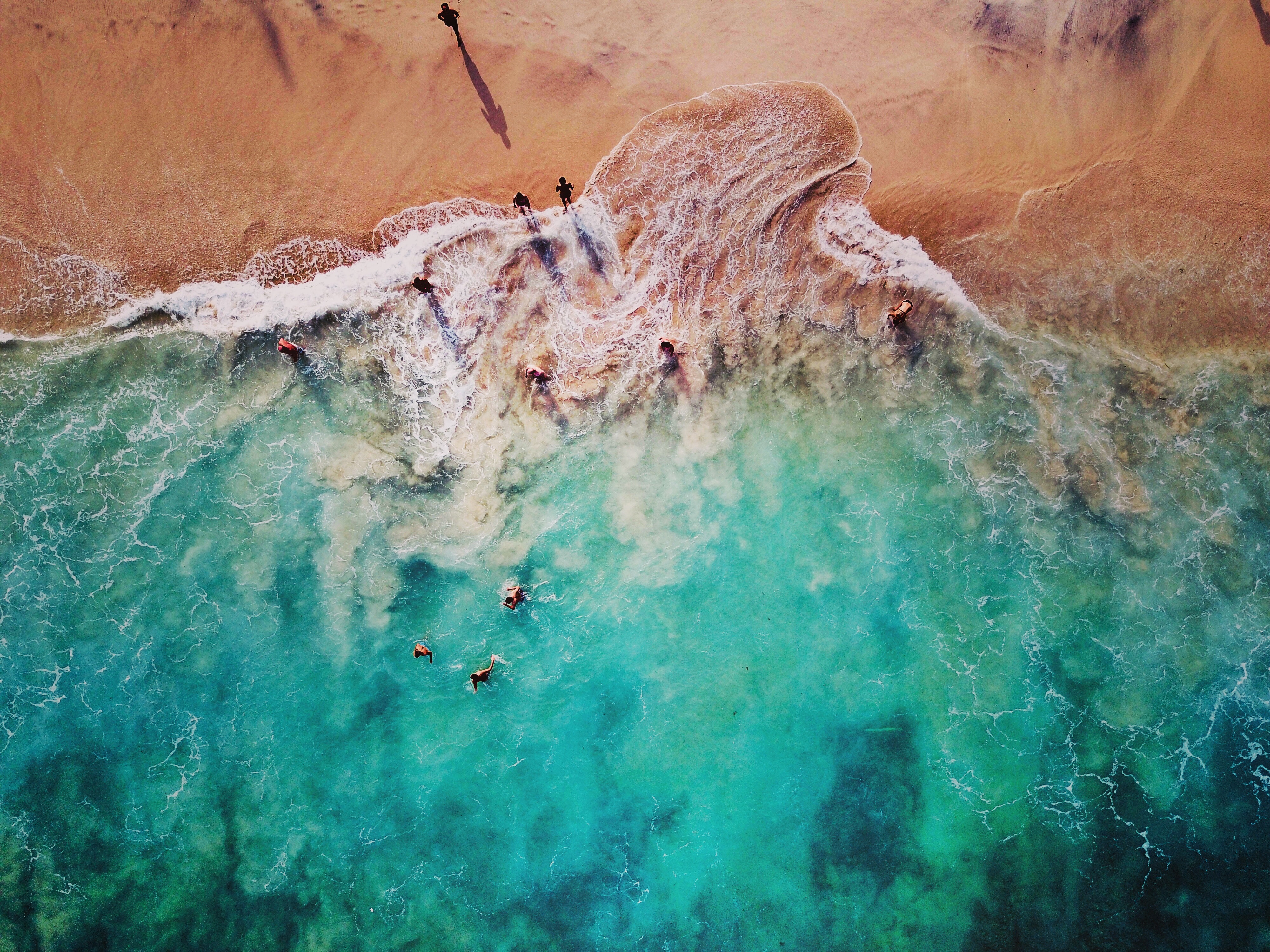 High-angle drone photo taken on the white sand beach in Bali
