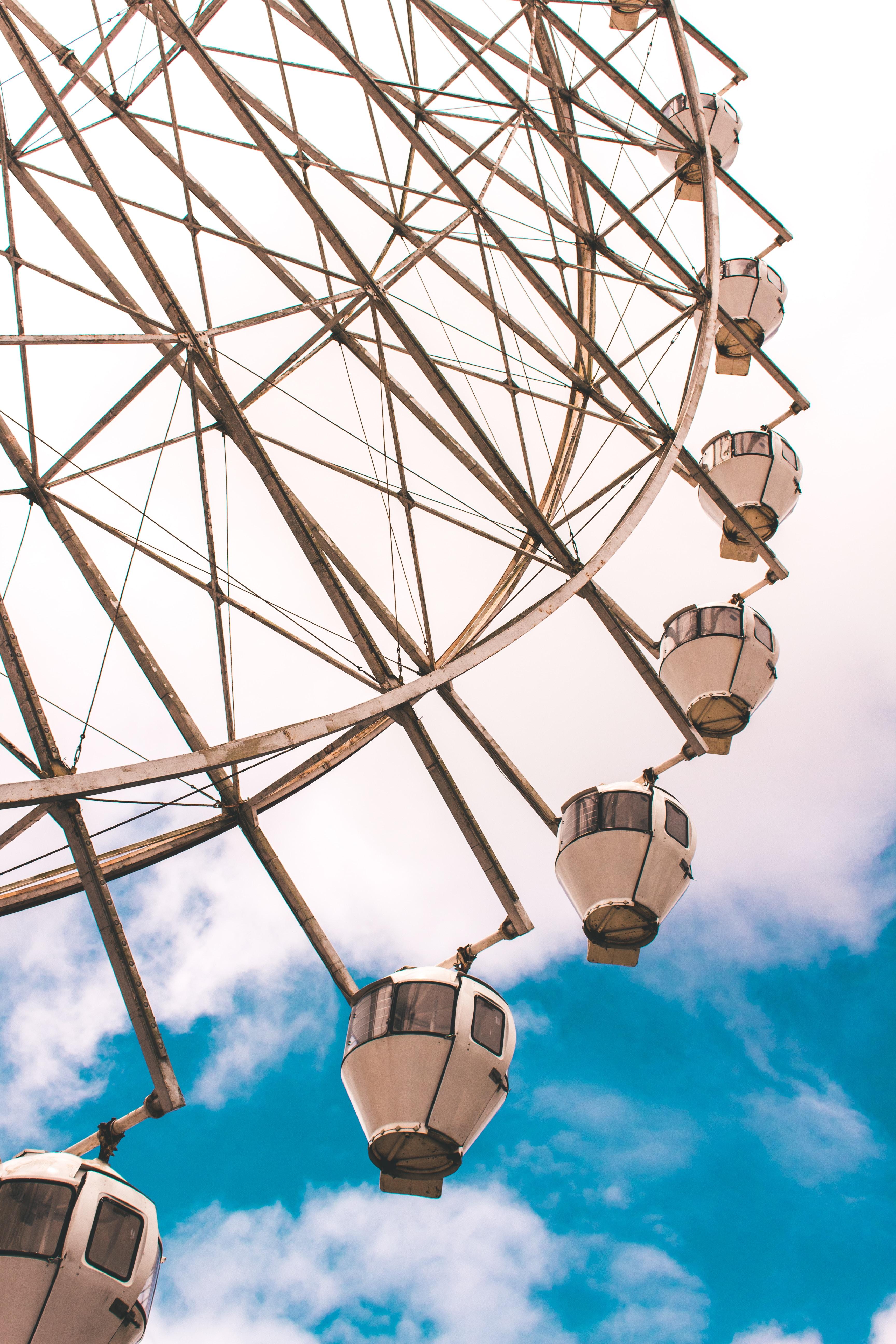 wormseye view of ferriswheel under blue sky