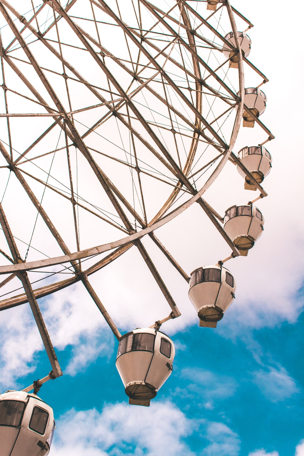 wormseye view of ferriswheel under blue sky
