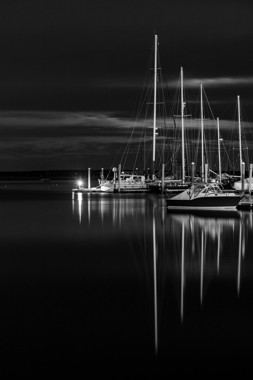 greyscale photo of boat on top of water
