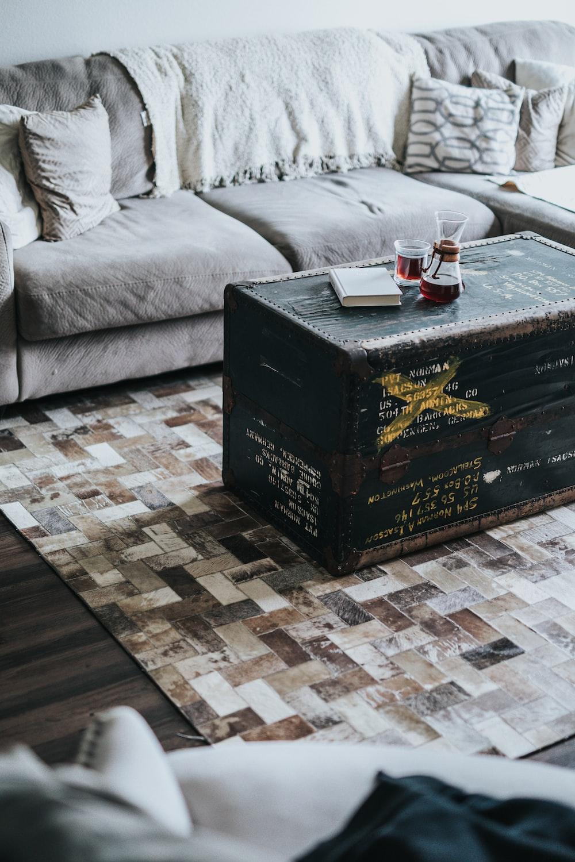 black ammo box coffee table between sofas