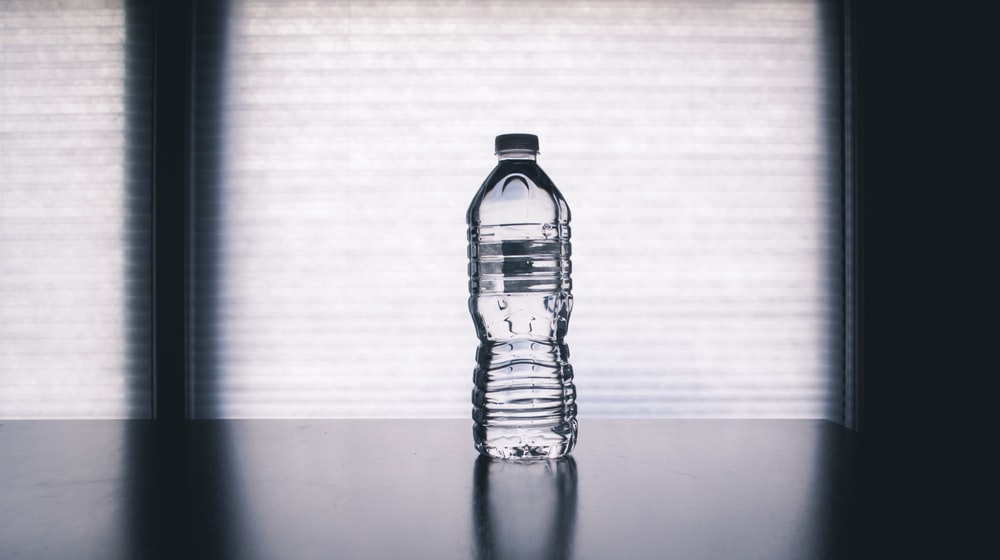 clear drinking bottle filled with water