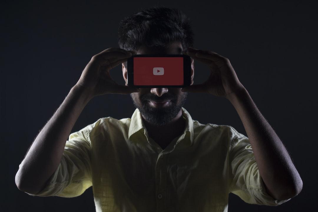 Man holding YouTube Phone Face