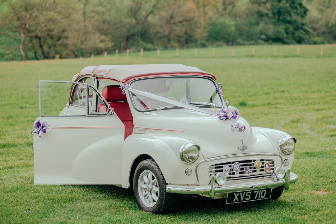 charlotte and tobys beautiful old wedding car. it suited their wedding day perfectly