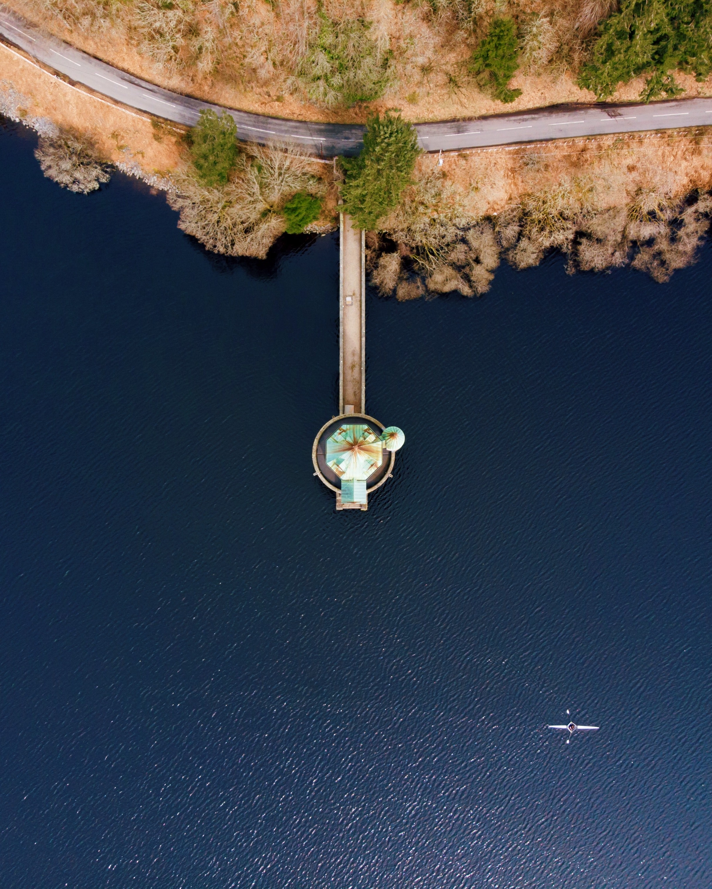 aerial view of dock on body of water beside island