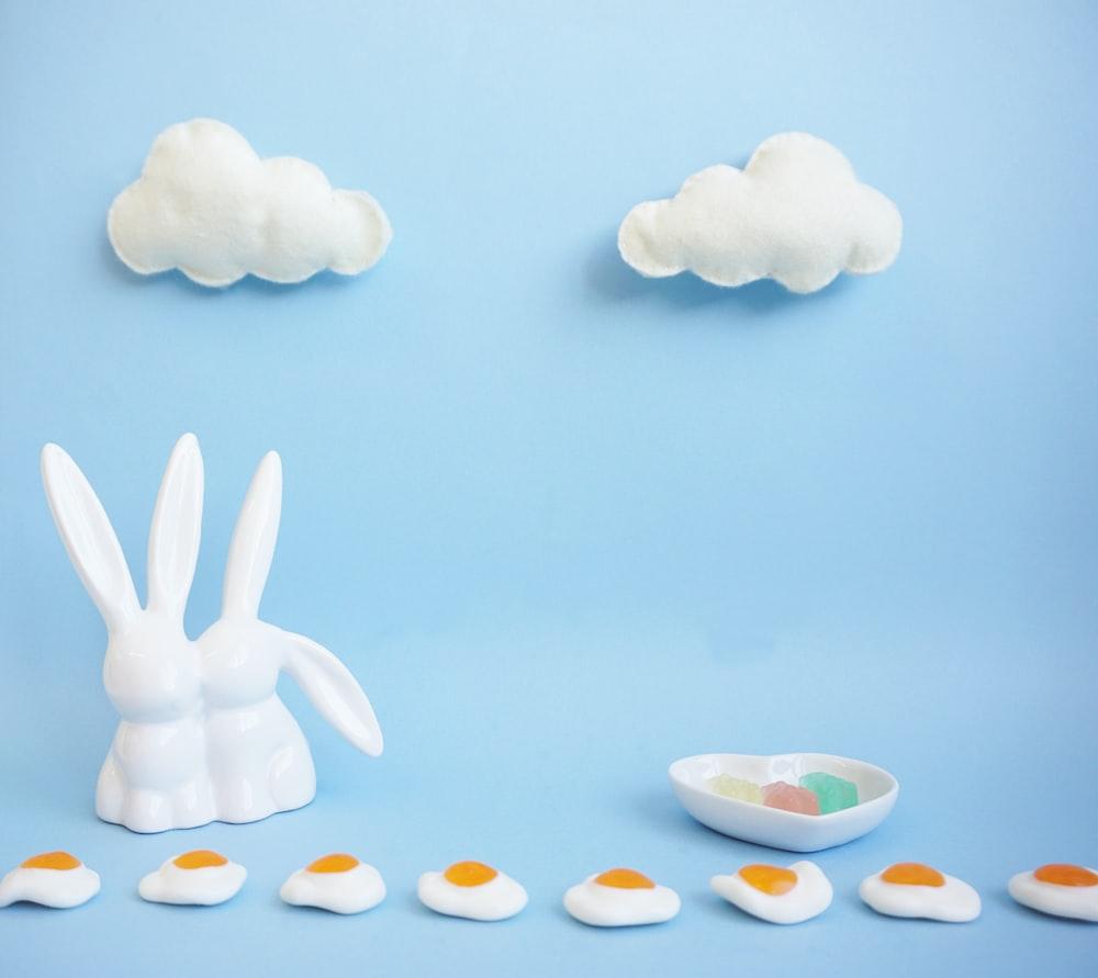 two white rabbit figurine
