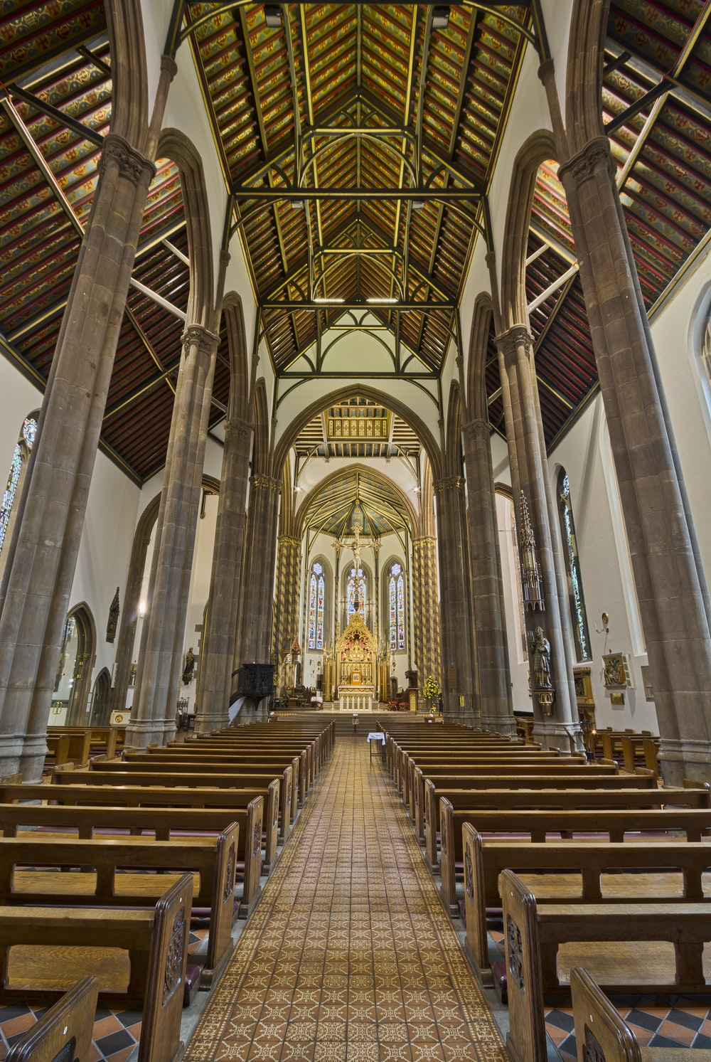 photo of white and brown concrete cathedral interior