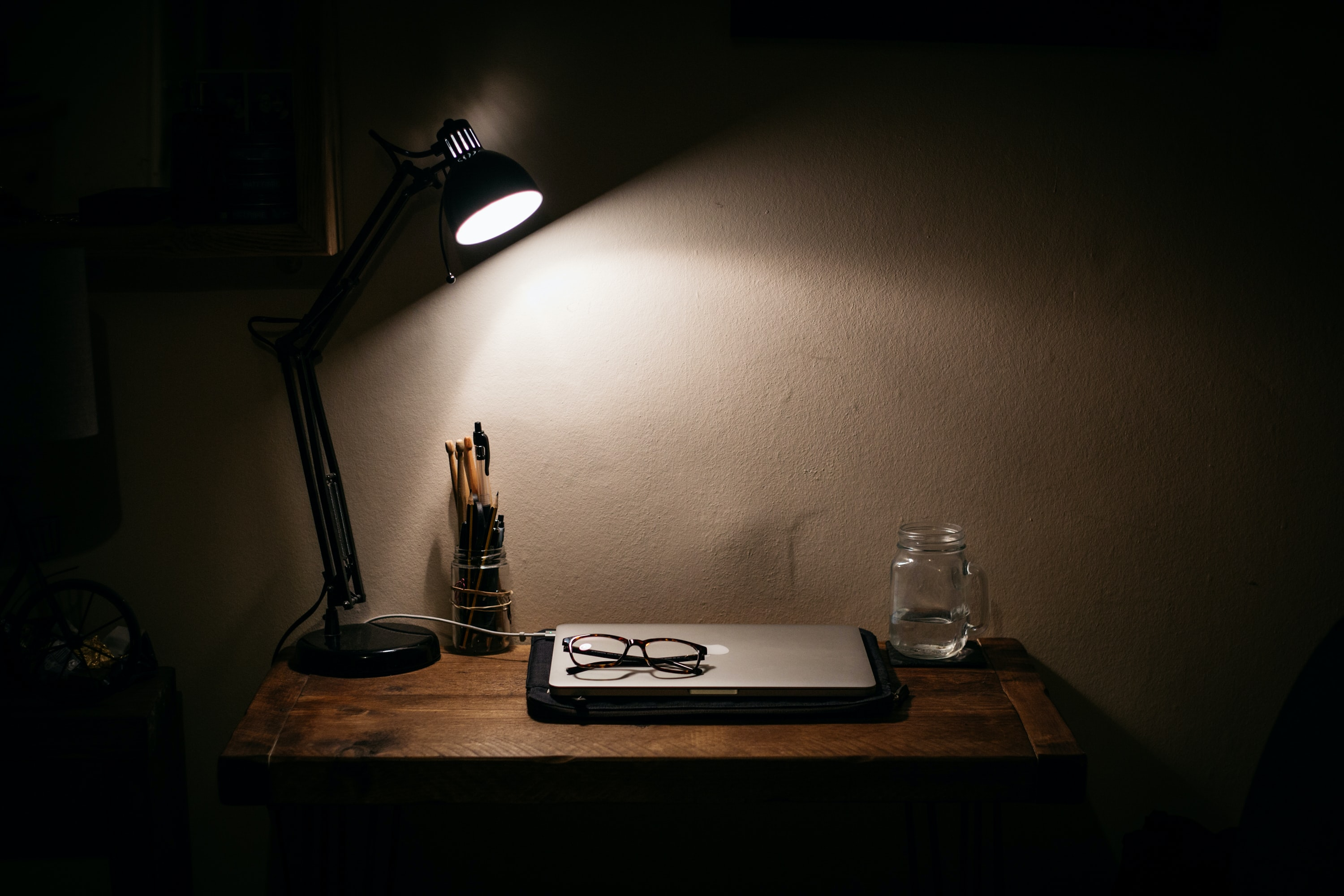 black desk lamp on brown wooden table