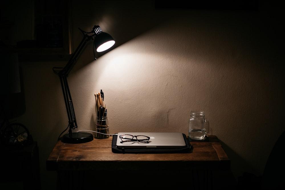 black desk lamp on brown wooden table
