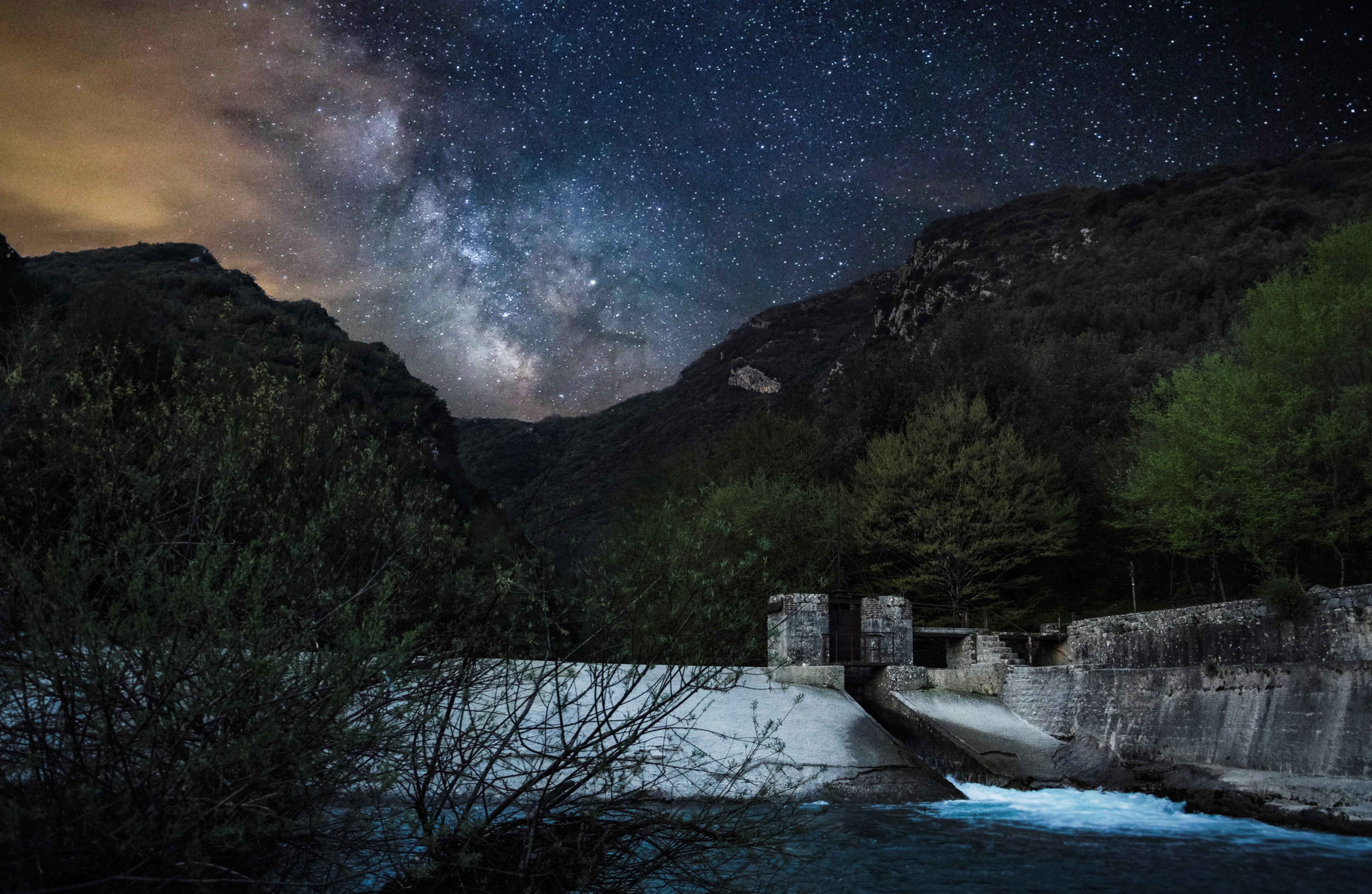 dam near mountain at night