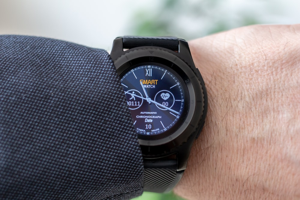 person showing smartwatch displaying 11:19