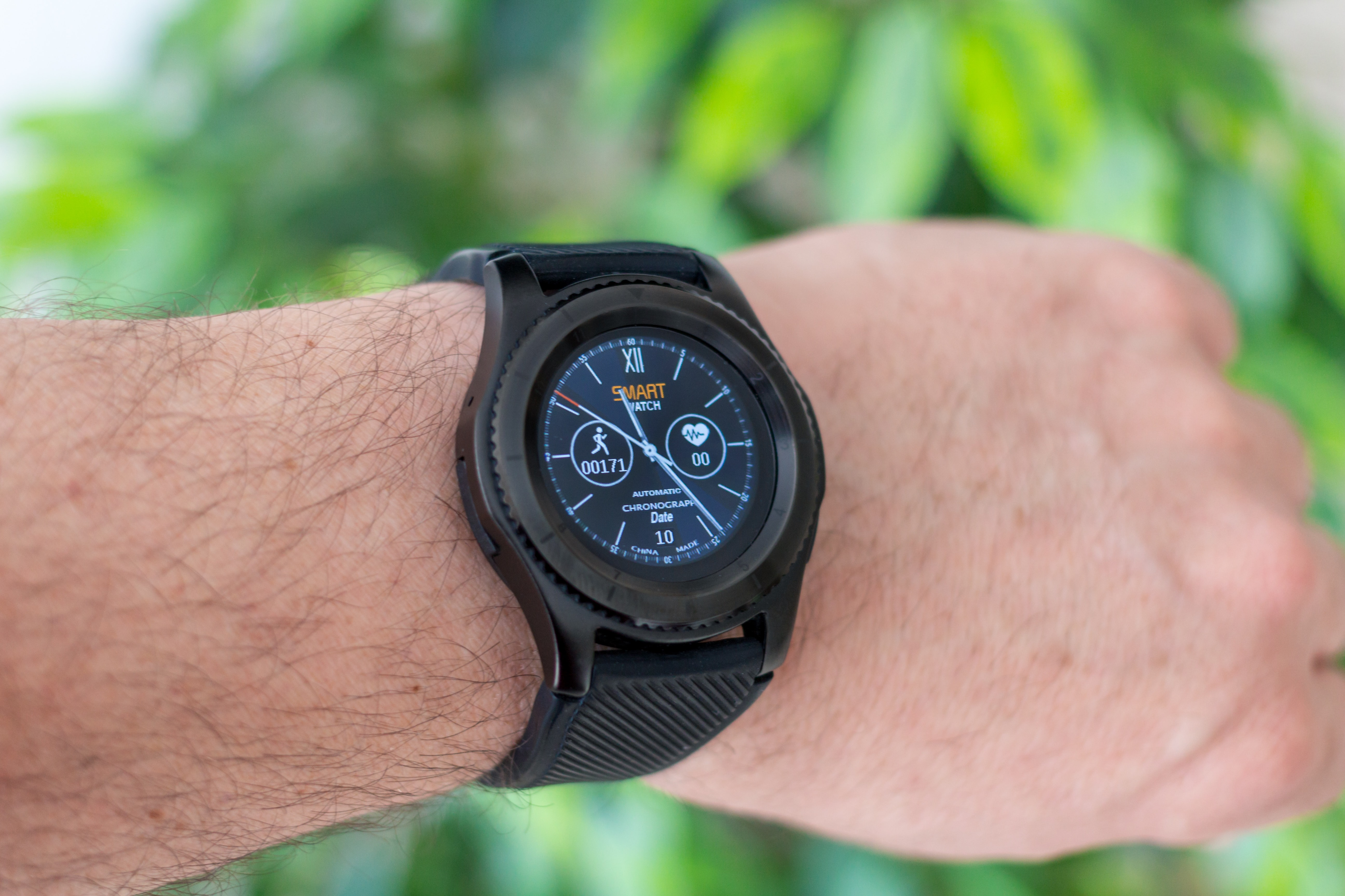 person wearing black smartwatch