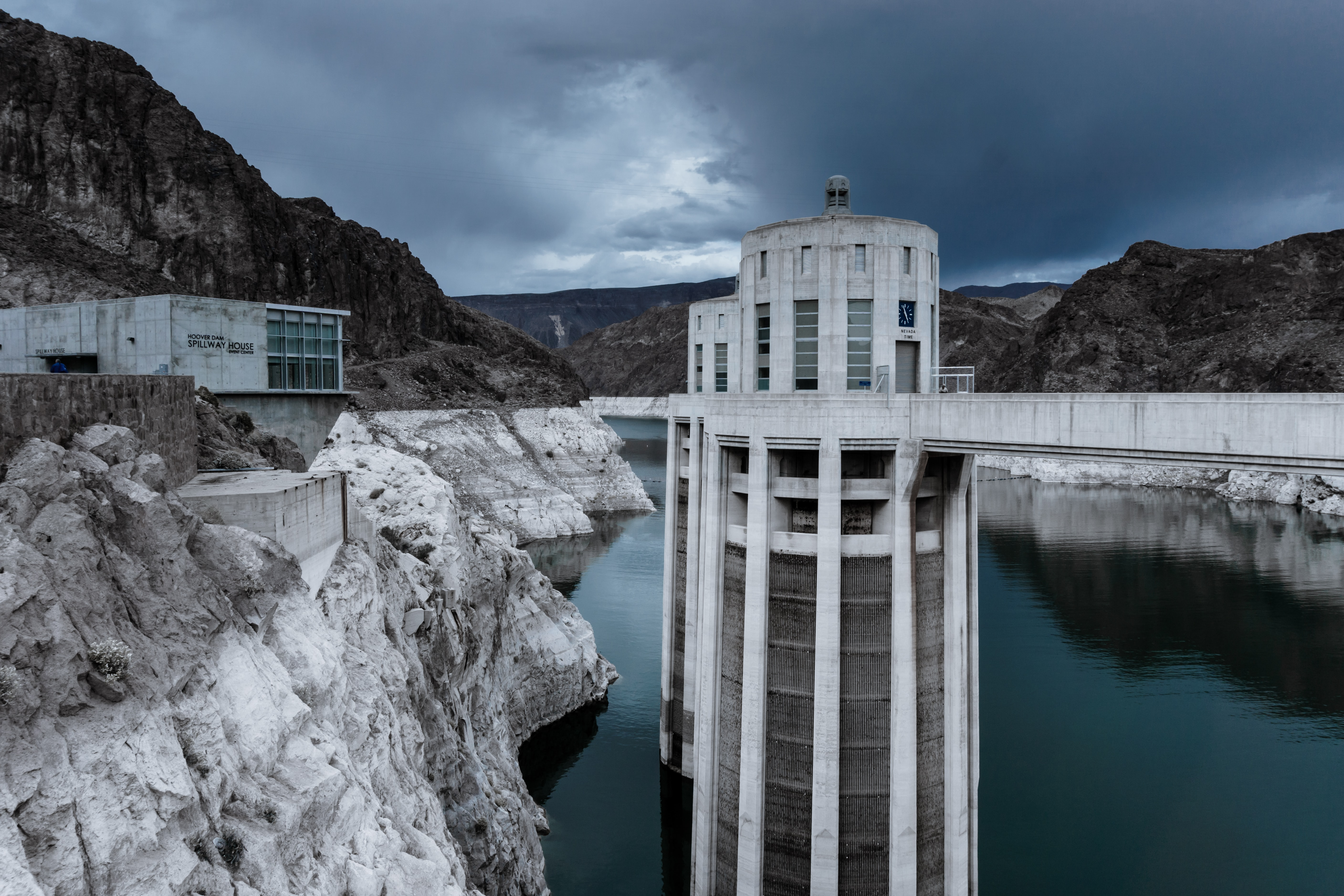 dam under dark clouds
