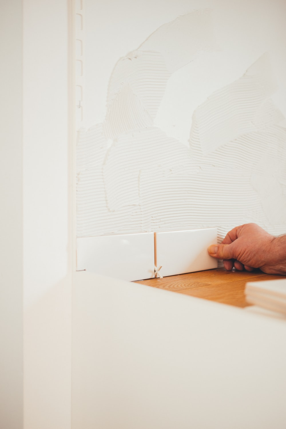 person holding white tile