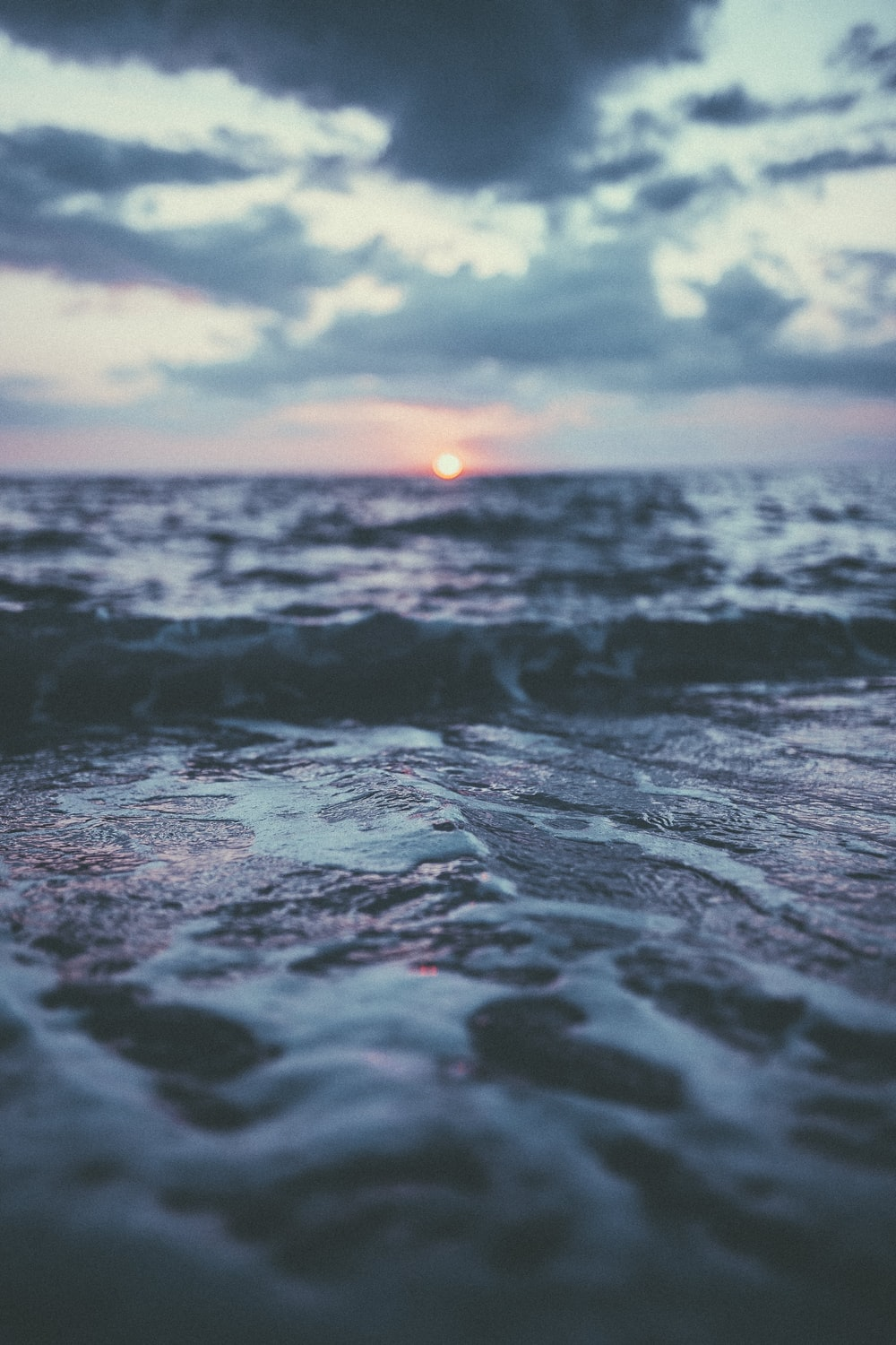 rippled ocean water at sunset