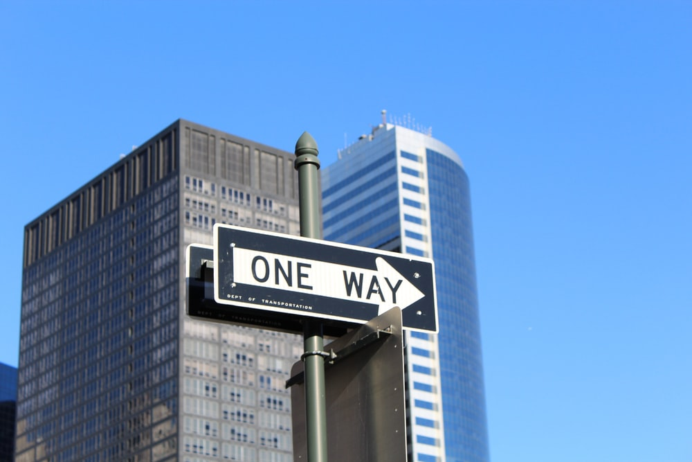 One Way signage on high-rise building