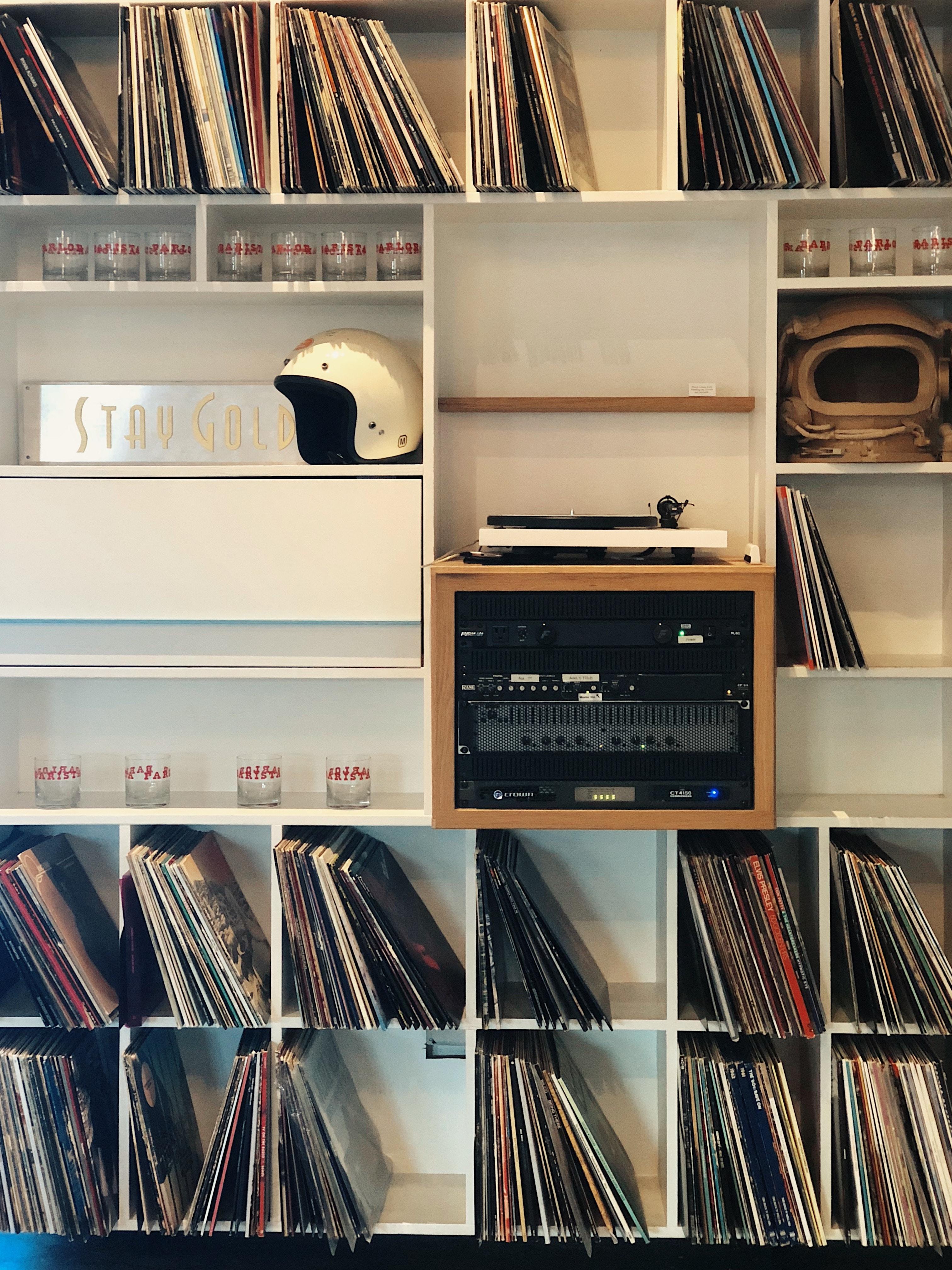 vinyl sleeves on white wooden cube shelf