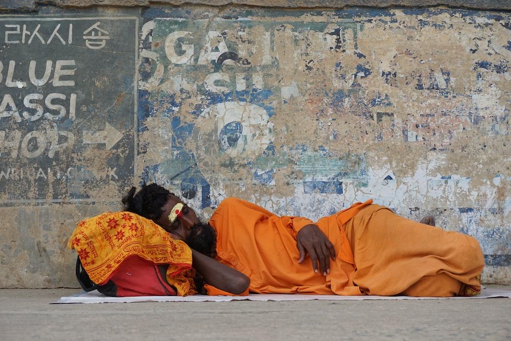 man lying down on street