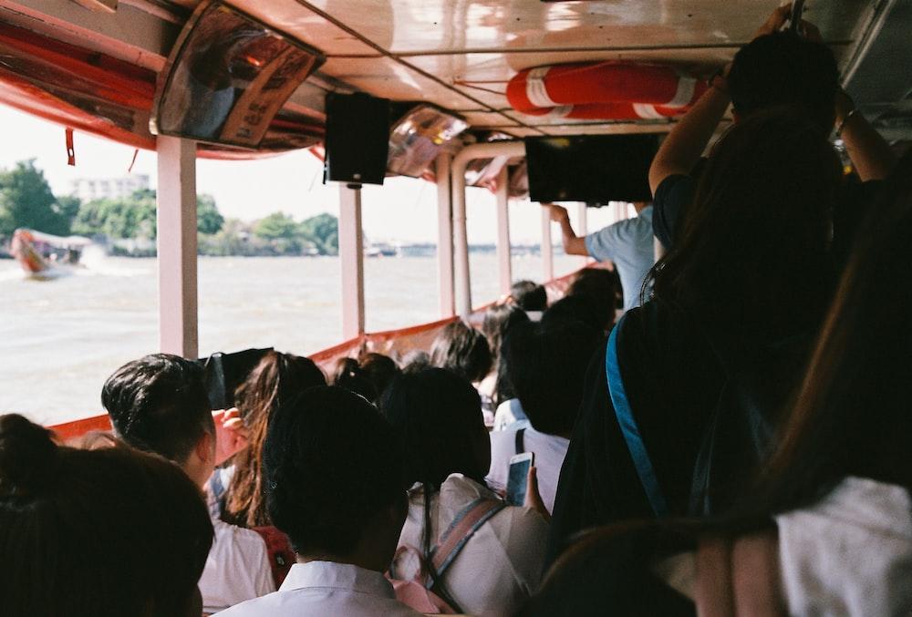 people riding bus during daytime