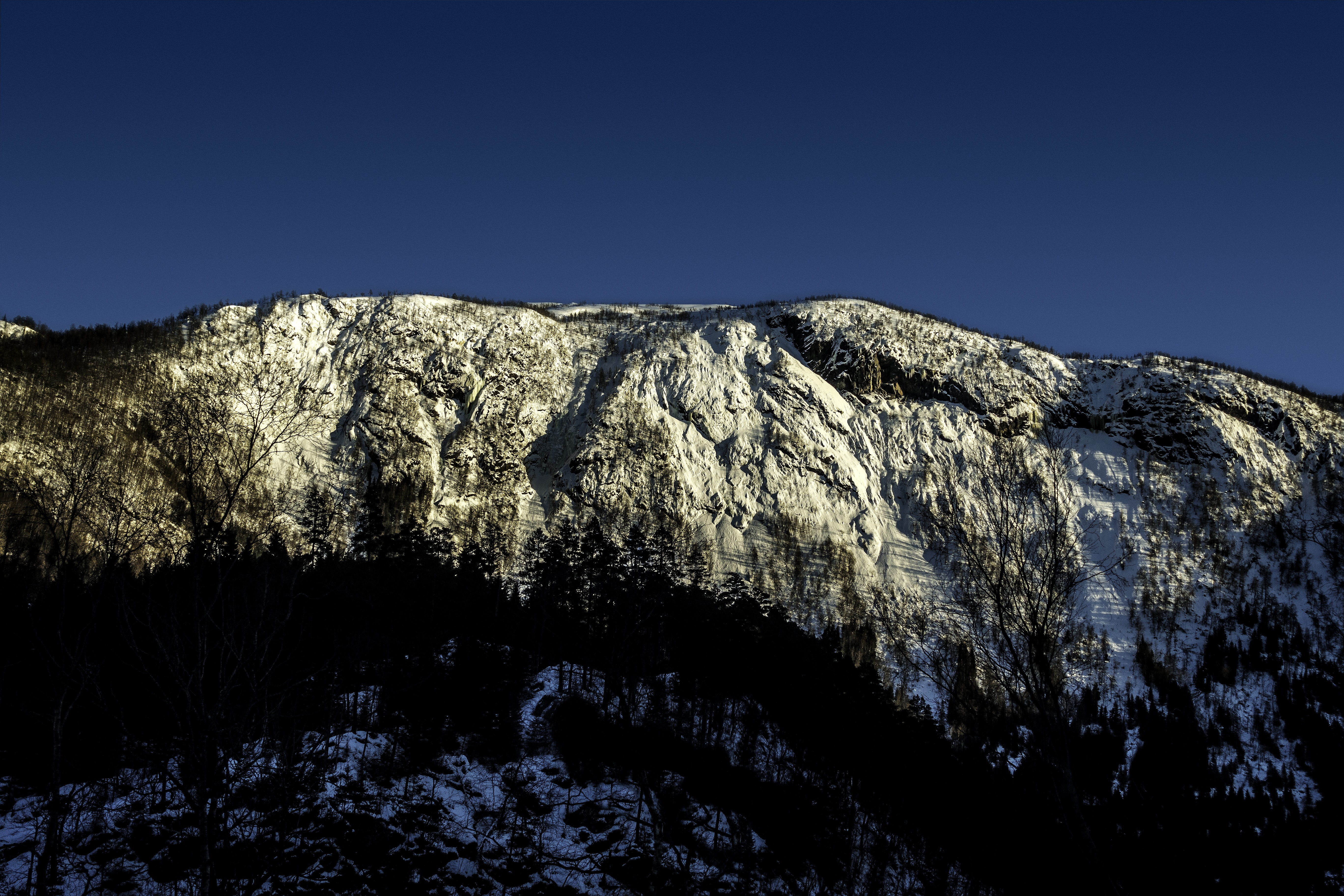 brown and white mountain cliff under blue sky