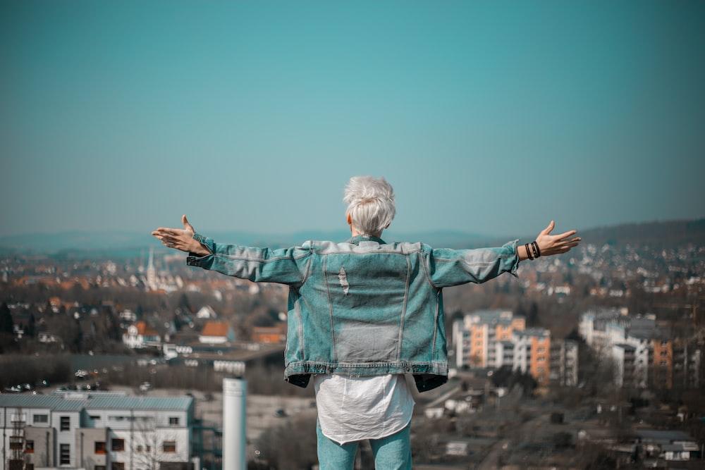 man raising hands on vignette photography