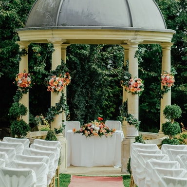 gray and beige gazebo near green leafed tree