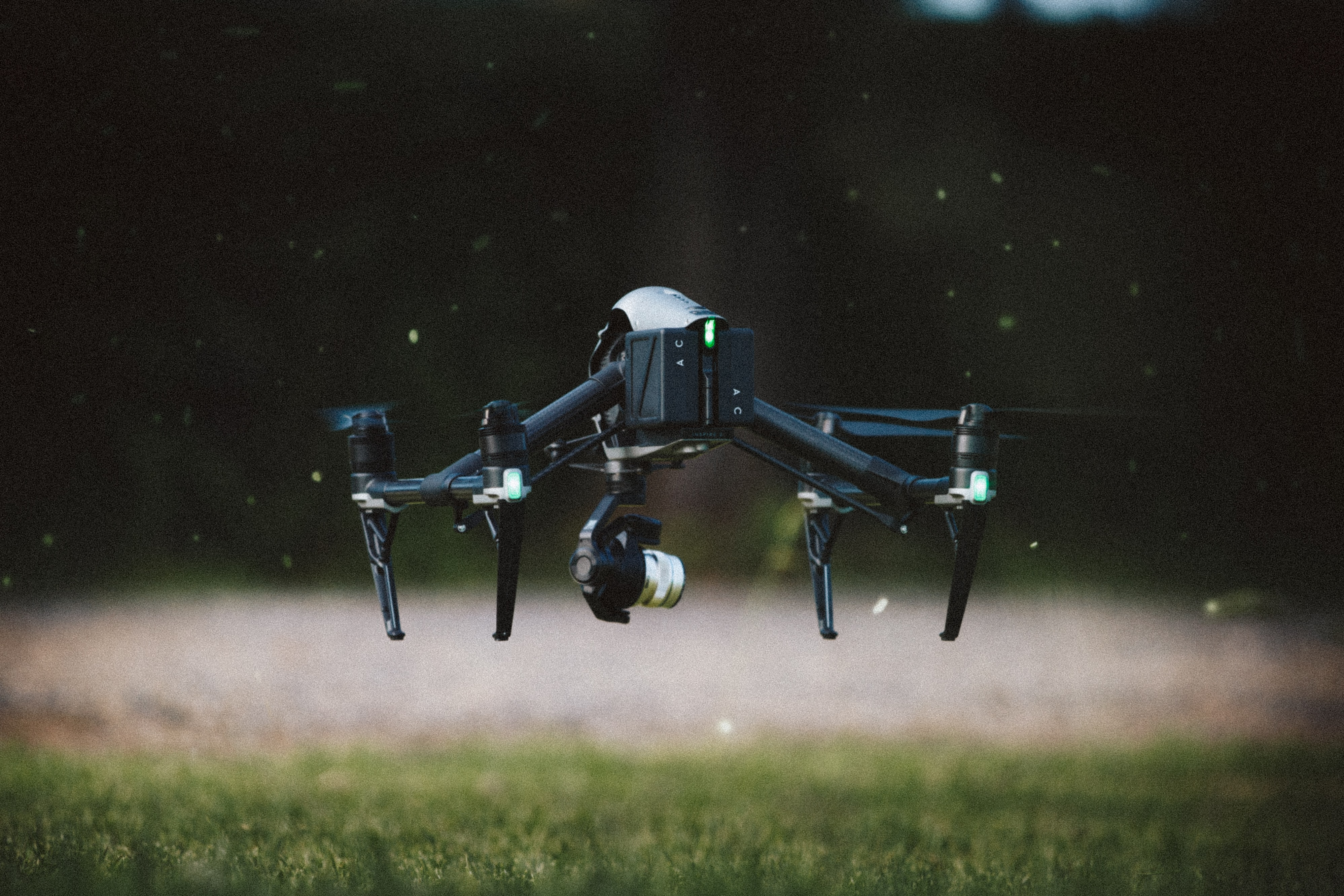 selective focus photography of black and gray quadcopter drone taking flight