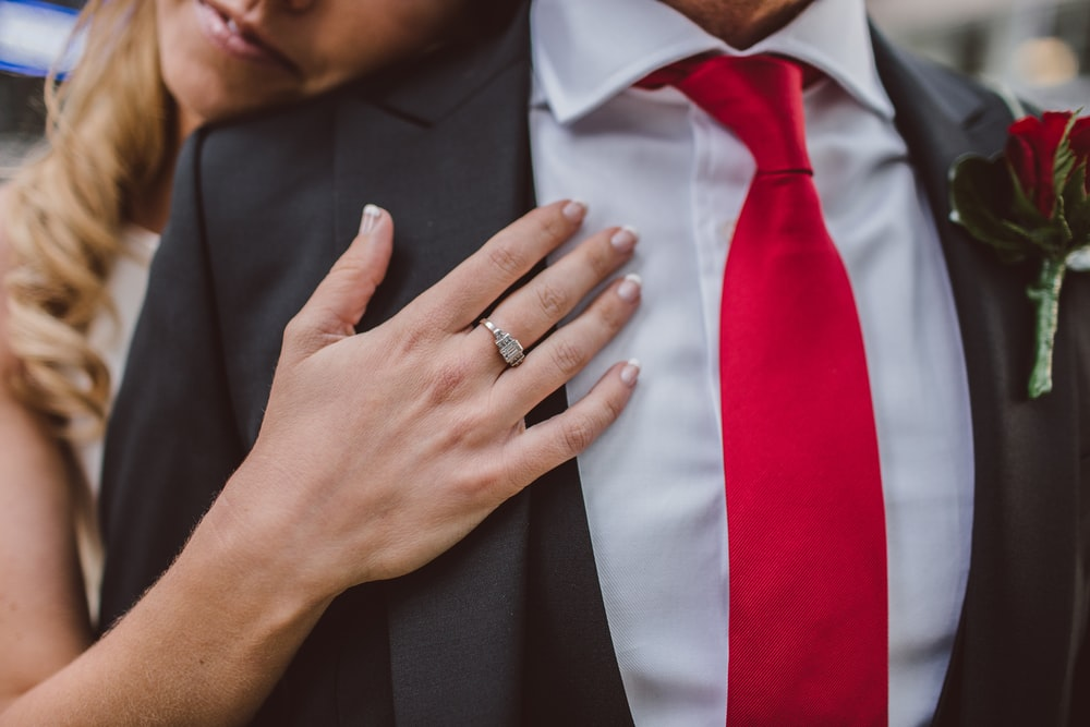 woman hugging man in suit jacket