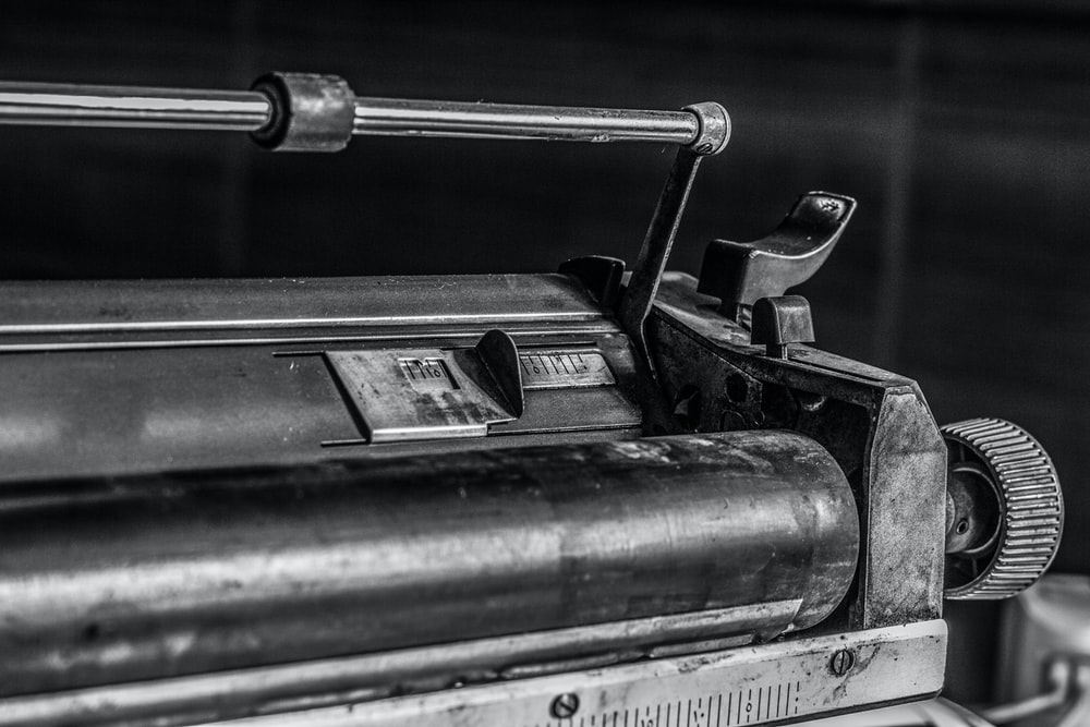 grayscale photography of a toner cartridge