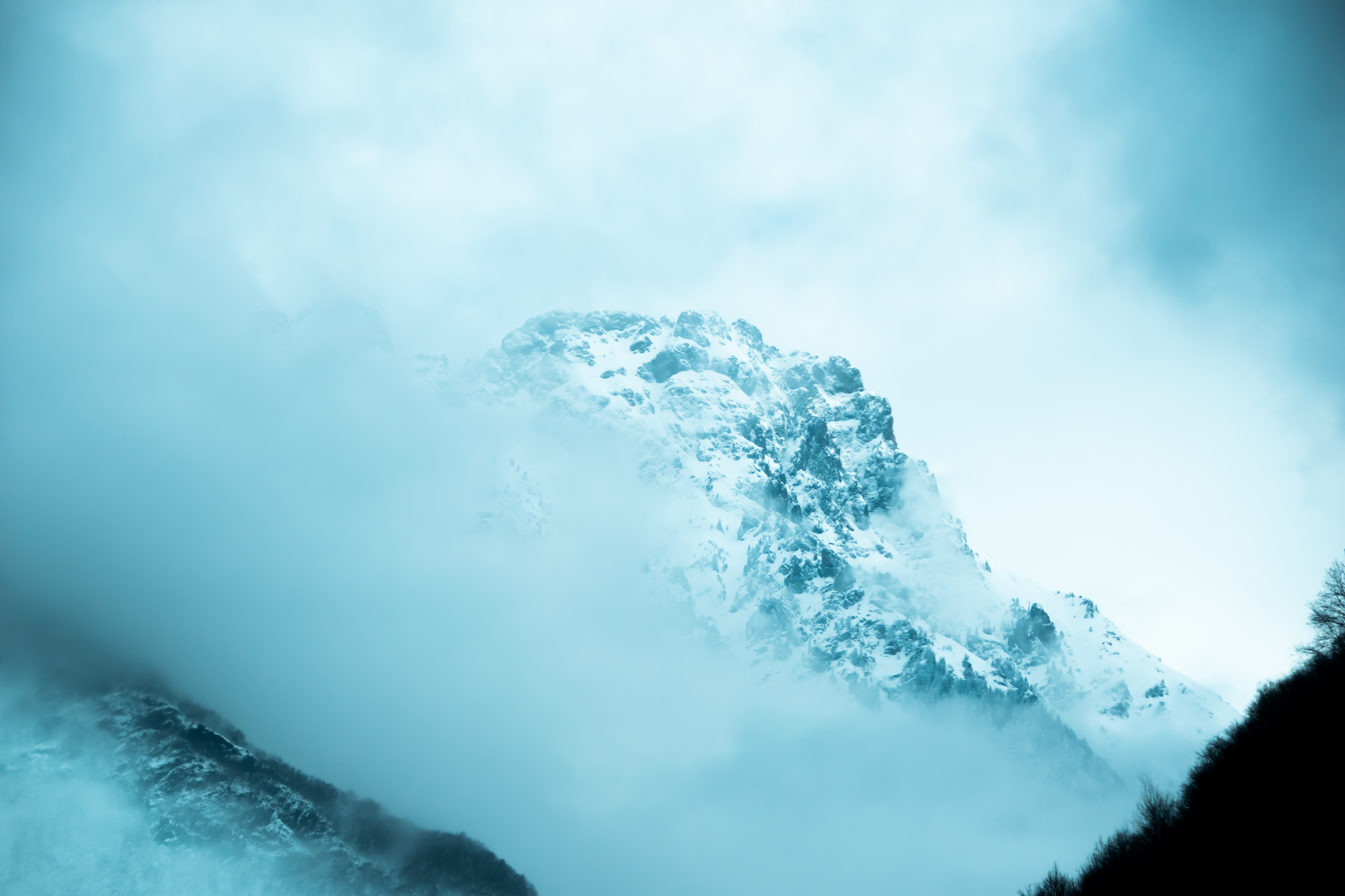 landscape photography of snow-capped mountain covered with fog