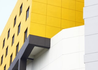 white and yellow high-rise building
