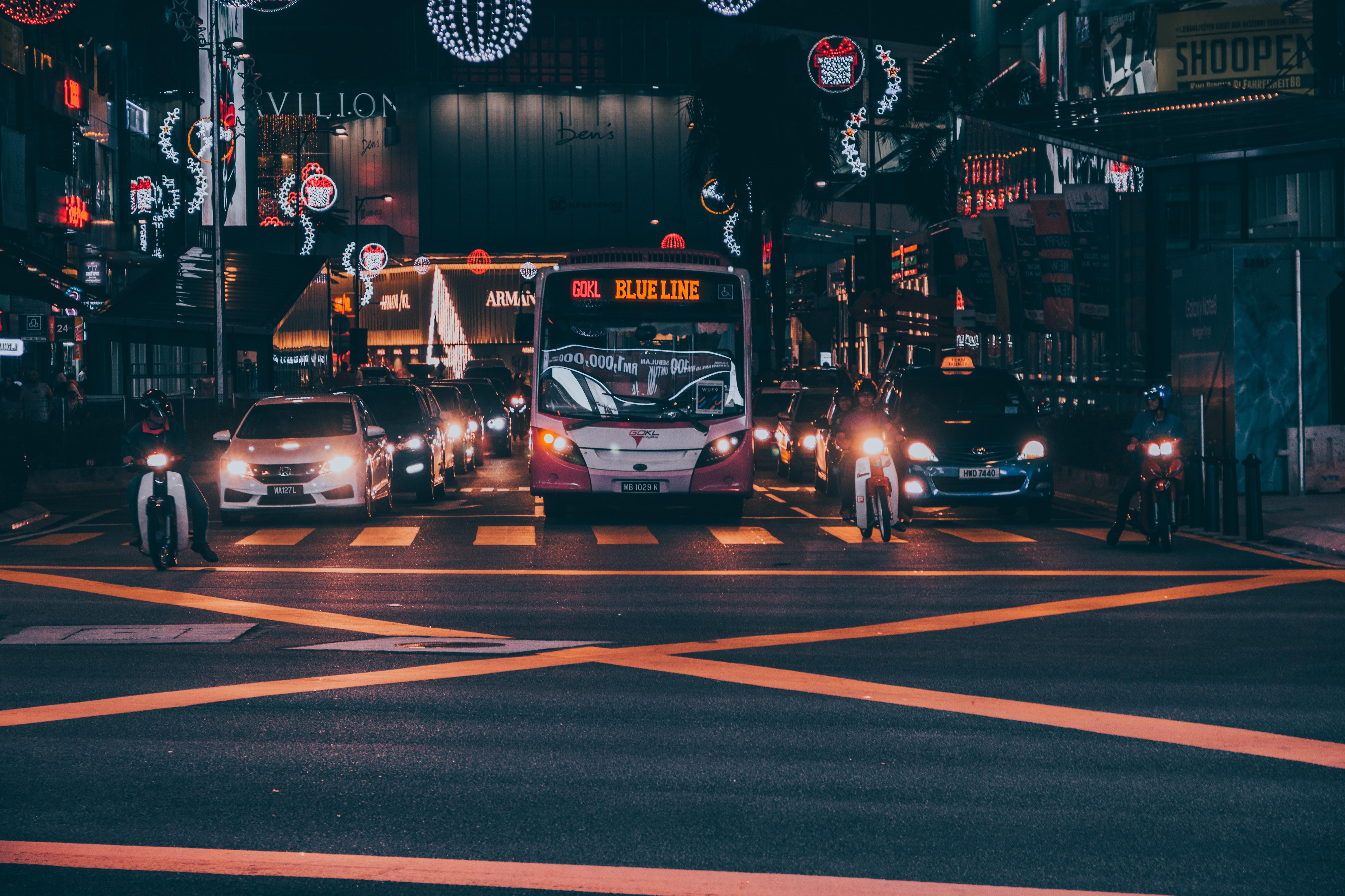 white bus on asphalt road