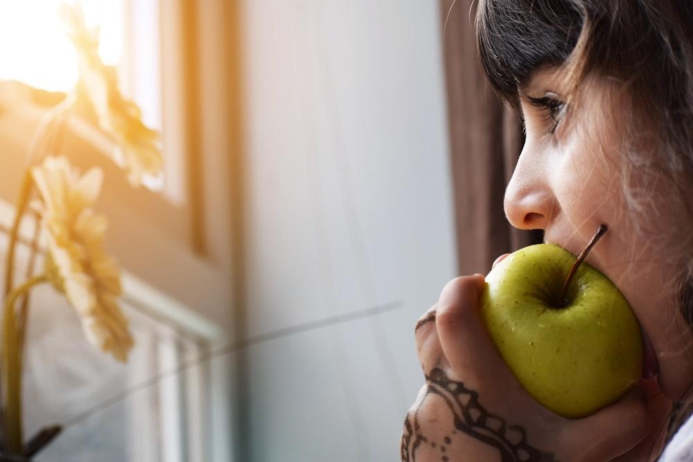 woman biting apple