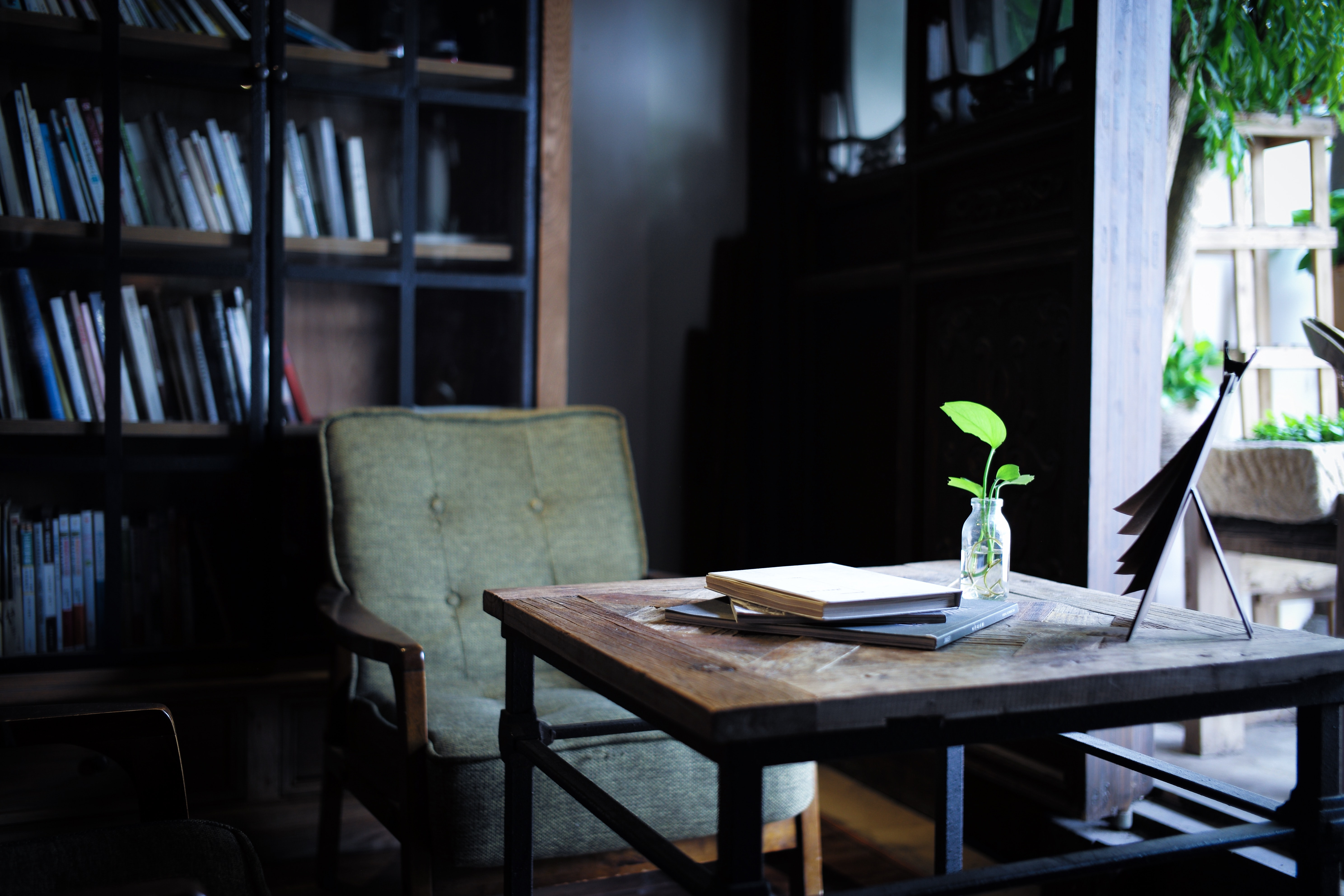 photo of green padded chair near brown wooden table