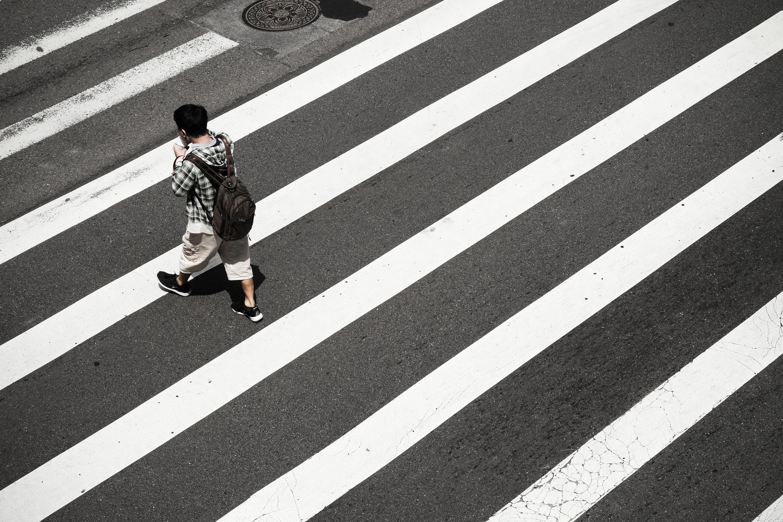 man crossing at pedestrian lane