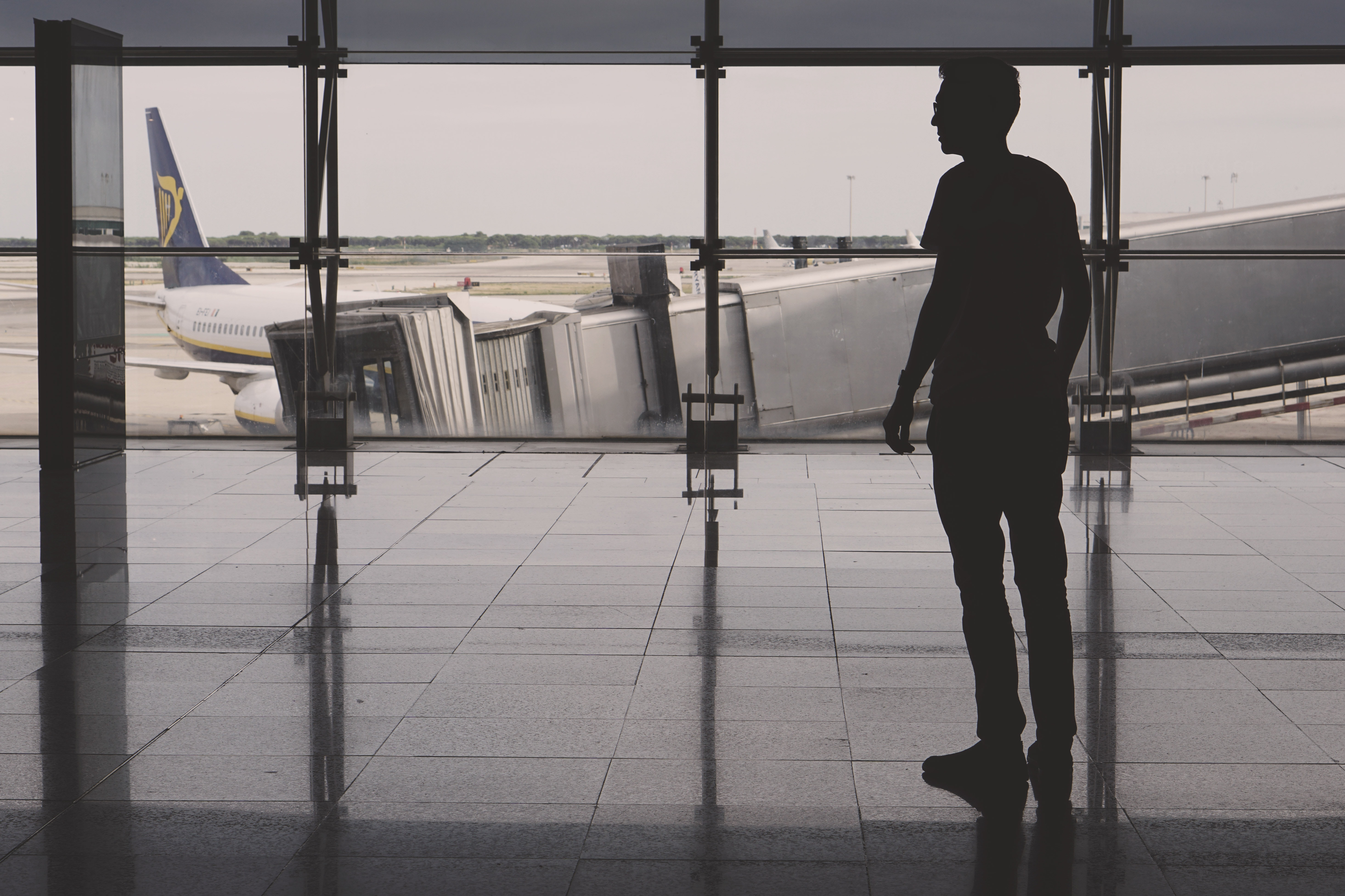 silhouette of man on airport lounge