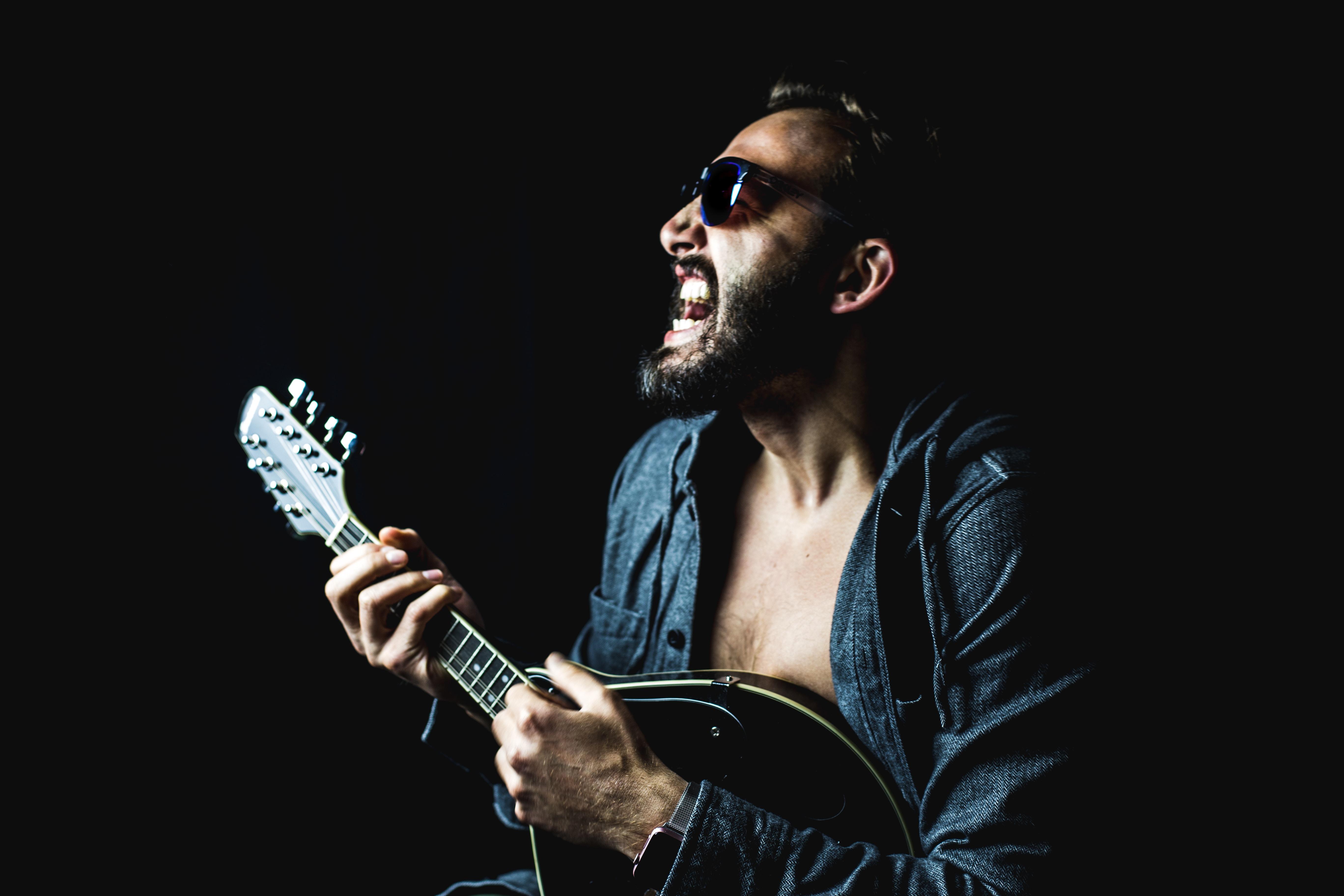 man playing string instrument