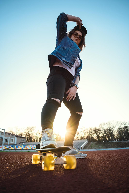woman stepping on cruiser board