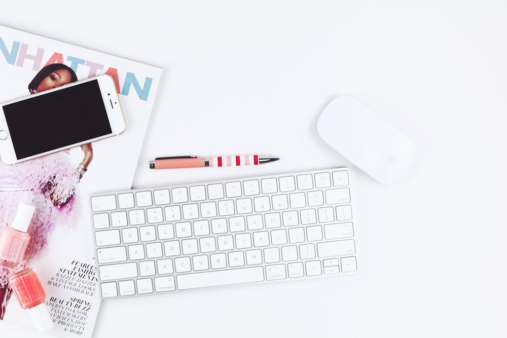 photo of Apple Magic Keyboard beside Apple Magic Mouse