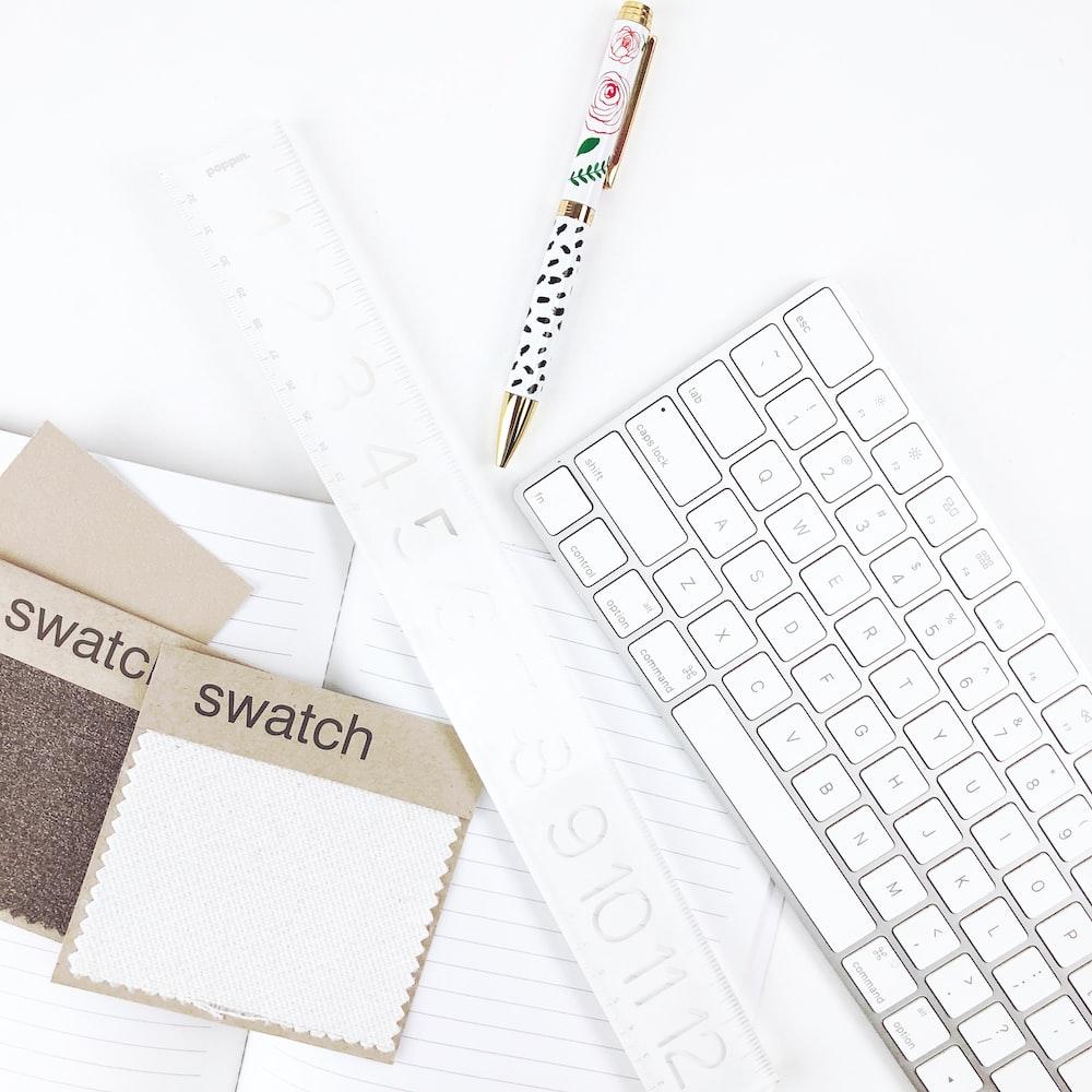 click pen beside laptop computer