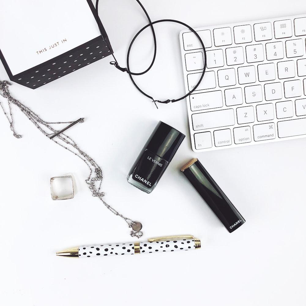 white and black click pen