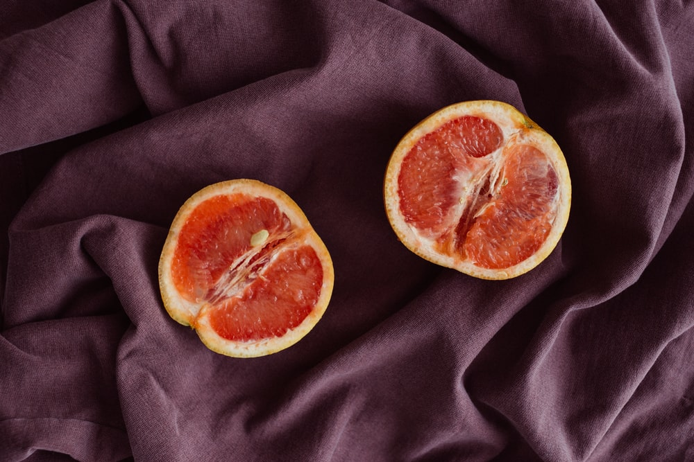 sliced red citrus fruit