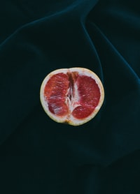 grapefruit on black surface
